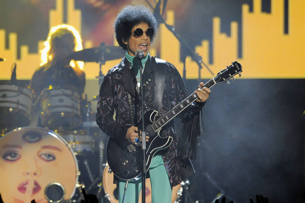 Prince performs May 19, 2013, at the Billboard Music Awards at the MGM Grand Garden Arena in Las Vegas. The Minnesota Court of Appeals said Monday, Sept. 11, 2017, that two descendants of a man Pr ...