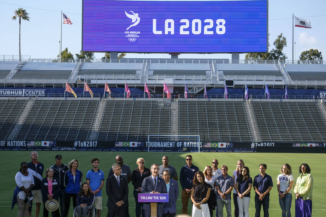Los Angeles Mayor Eric Garcetti, center, speaks during a press conference to make an announcement for the city to host the Olympic Games and Paralympic Games 2028, at Stubhub Center in Carson, out ...