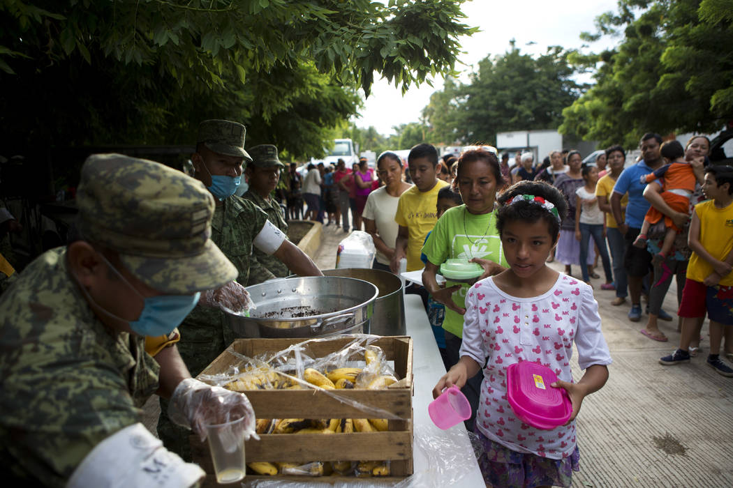 Soldiers serve breakfast to people sheltering at a technology school after their homes were destroyed or damaged in Thursday's magnitude 8.1 earthquake, in Juchitan, Oaxaca state, Mexico, Monday,  ...