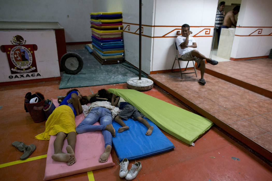 People sleep inside a gymnasium at a technology school serving as a shelter for residents who fled their destroyed or damaged homes after Thursday's magnitude 8.1 earthquake, in Juchitan, Oaxaca s ...