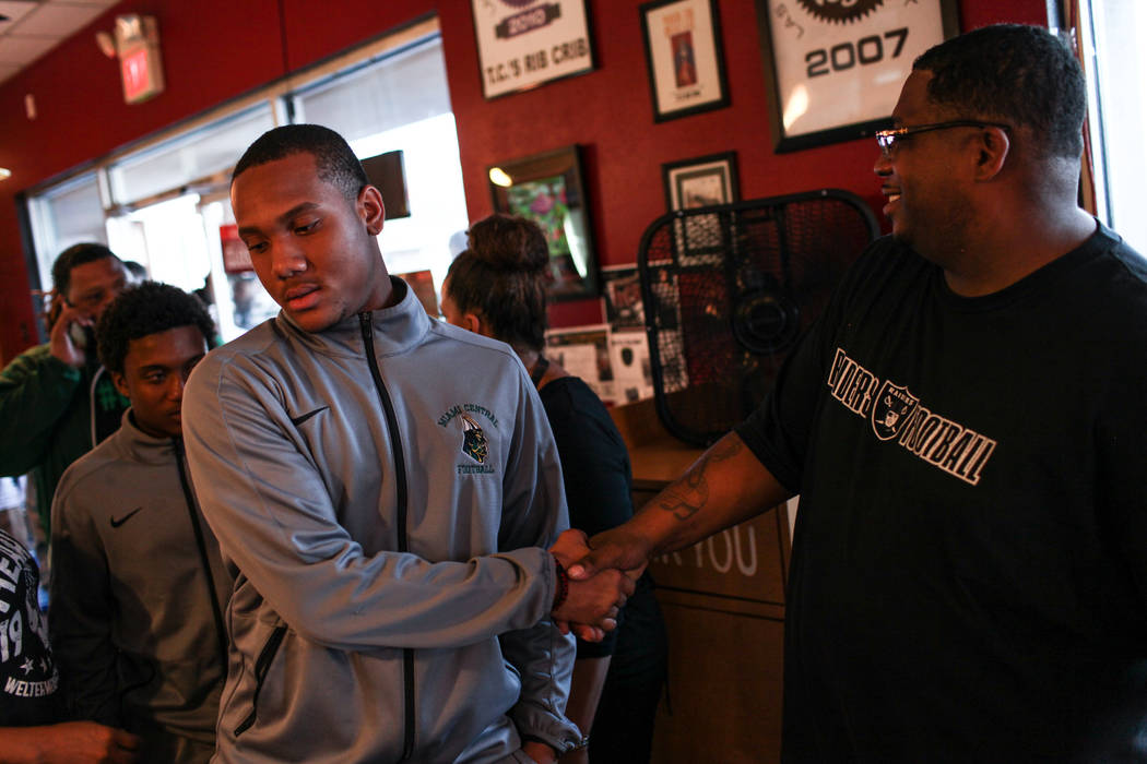 "Miami Central's Michael Williams, left, is greeted by Marlon ""DJ Thump"" Rice, right, before a dinner at TC's Rib Crib in Las Vegas, Monday, Sept. 11, 2017. Joel Angel Juarez Las Vegas Review-Journ ..."