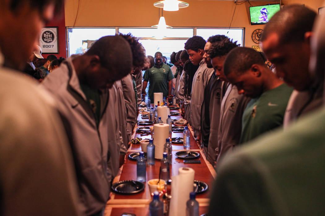 Miami Central's football team prays before a dinner at TC's Rib Crib in Las Vegas, Monday, Sept. 11, 2017. Joel Angel Juarez Las Vegas Review-Journal @jajuarezphoto