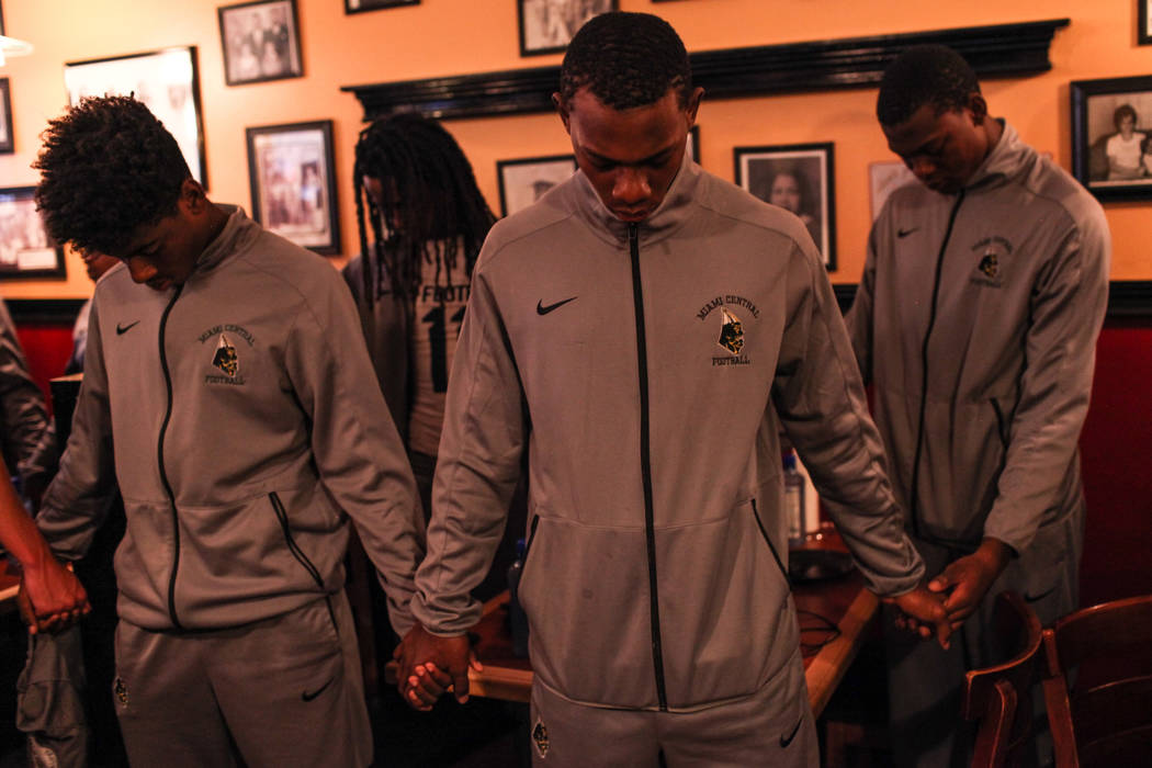 Miami Central's Zeryus Coleman, center, prays with his football team before a dinner at TC's Rib Crib in Las Vegas, Monday, Sept. 11, 2017. Joel Angel Juarez Las Vegas Review-Journal @jajuarezphoto