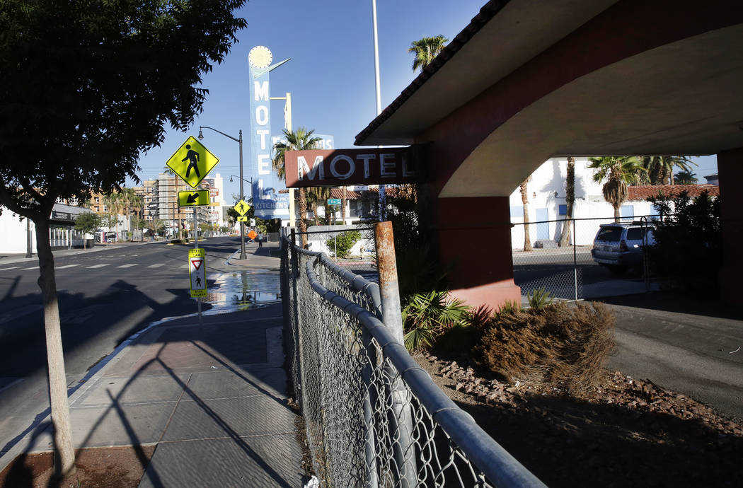 A boarded up Travelers Motel on 1100 Fremont St., right, and Motel Fergusons on 1028 Fremont St., in downtown Las Vegas on Tuesday, Sept. 12, 2017. Bizuayehu Tesfaye Las Vegas Review-Journal @bizu ...