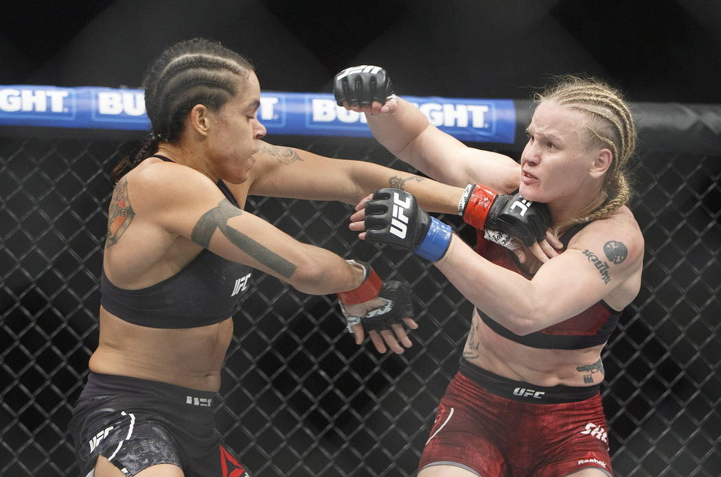 Amanda Nunes, left, of Brazil, punches Valentina Shevchenko, of Kyrgyzstan, during their mixed martial arts bout at UFC 215 in Edmonton, Alberta, Saturday, Sept. 9, 2017. (Jason Franson/The Canadi ...