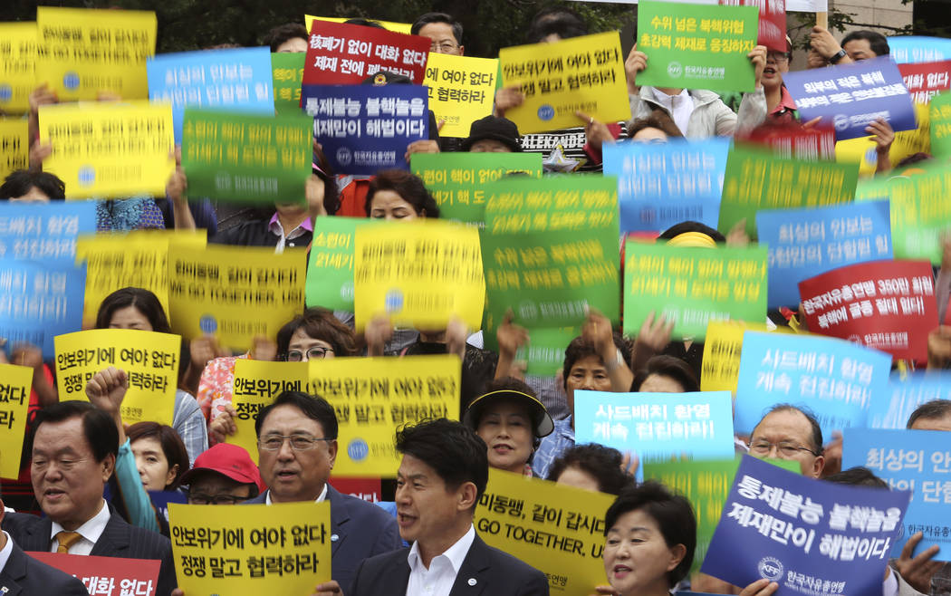 Members of Korea Freedom Federation shout slogans during a rally to denounce North Korea's nuclear test in Seoul, South Korea, Monday, Sept. 11, 2017. North Korea says it will make the United Stat ...