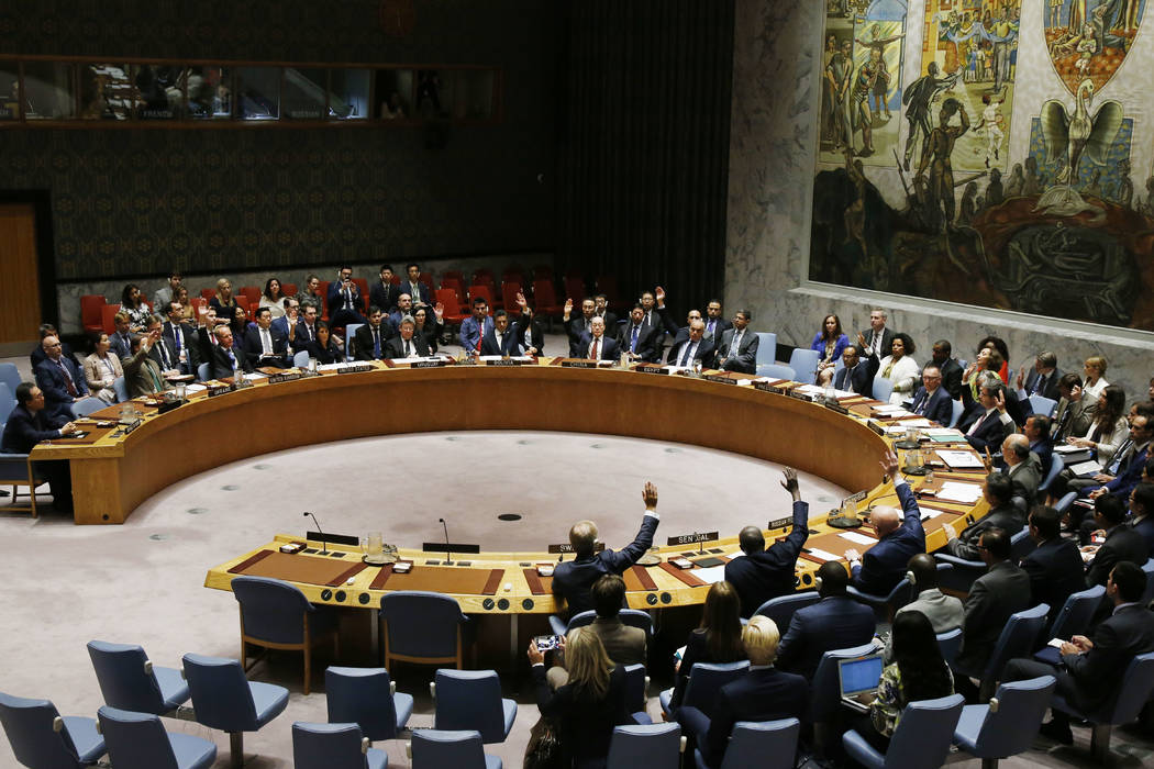 The United Nations Security Council votes to pass a new sanctions resolution against North Korea during a meeting at U.N. headquarters, Monday, Sept. 11, 2017. (Jason DeCrow/AP)