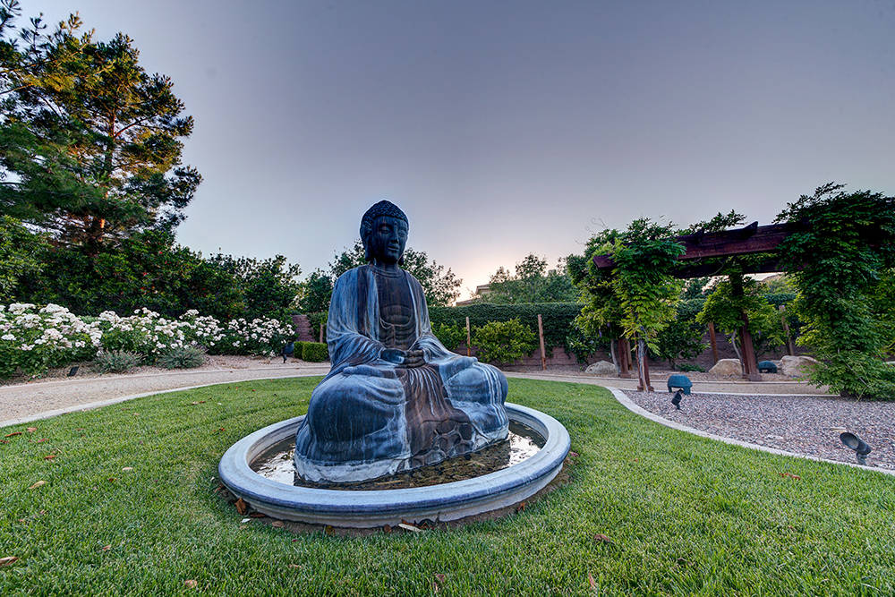 The adjacent lot to the Southern Highlands home was made into a private park, which includes walking and running trails and a Zen garden with a statute of Buddah. (The Napoli Group)
