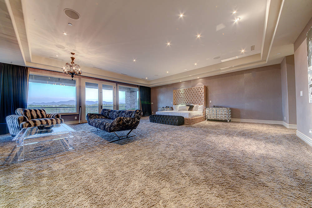 The Large master bedroom has wool carpet and a balcony overlooking the Southern Highlands golf course. (The Napoli Group)
