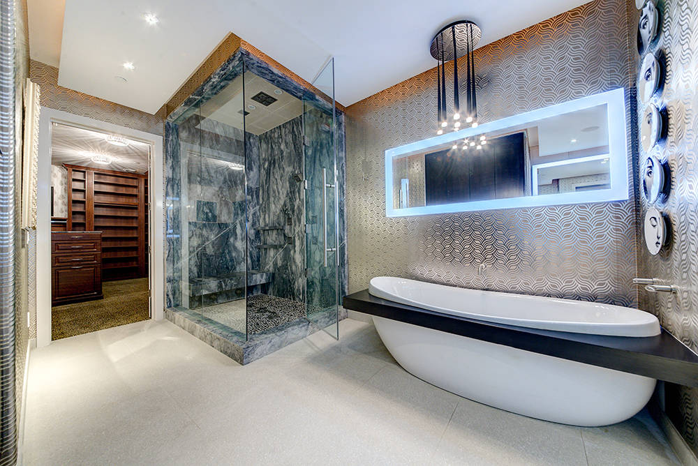 The master bedroom has his-and-her baths and closets. (The Napoli Group)