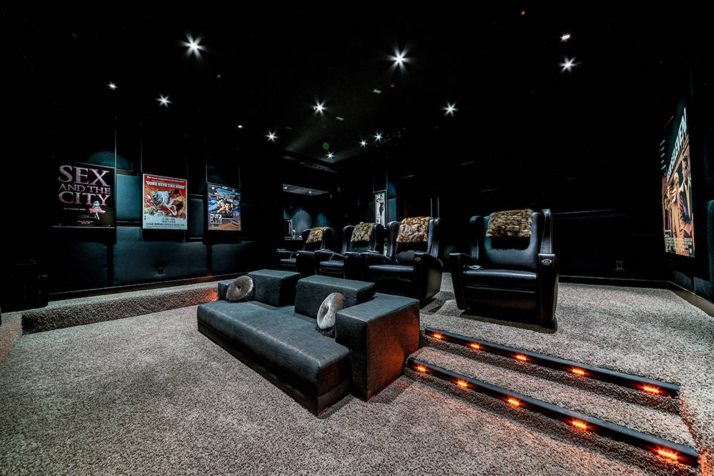 The home's theater is hidden behind a wooden panel wall near the entrance of the home. (The Napoli Group)