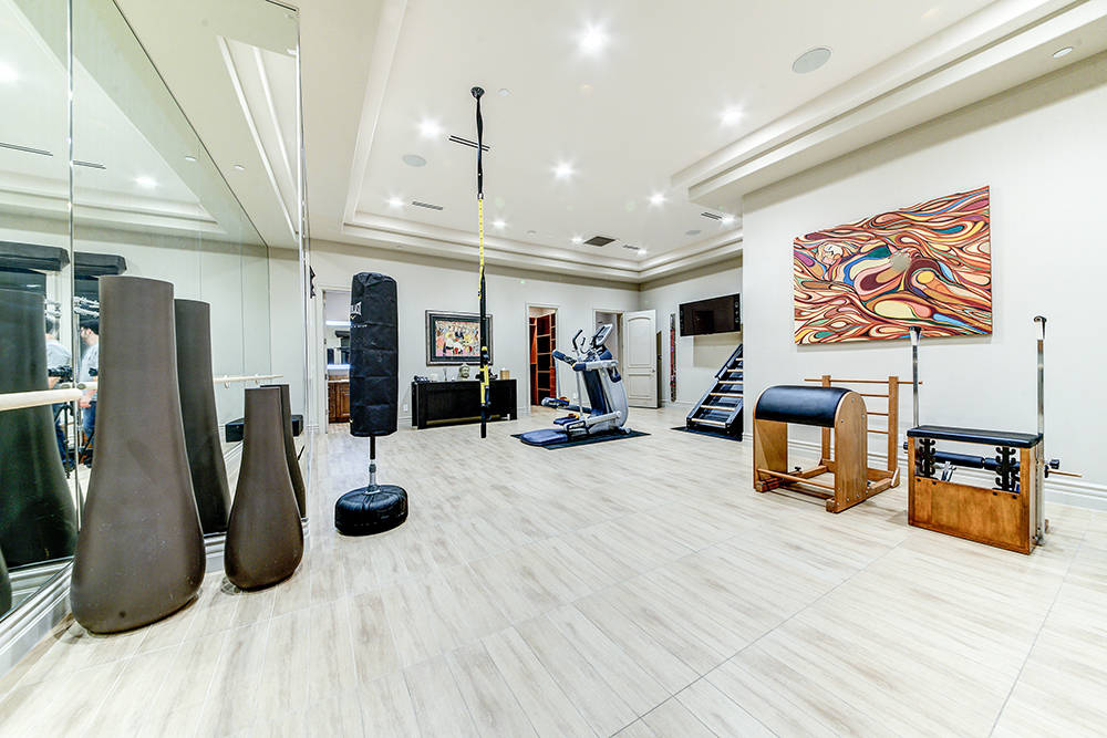 A room on the first floor was designed as a full gym. (The Napoli Group)