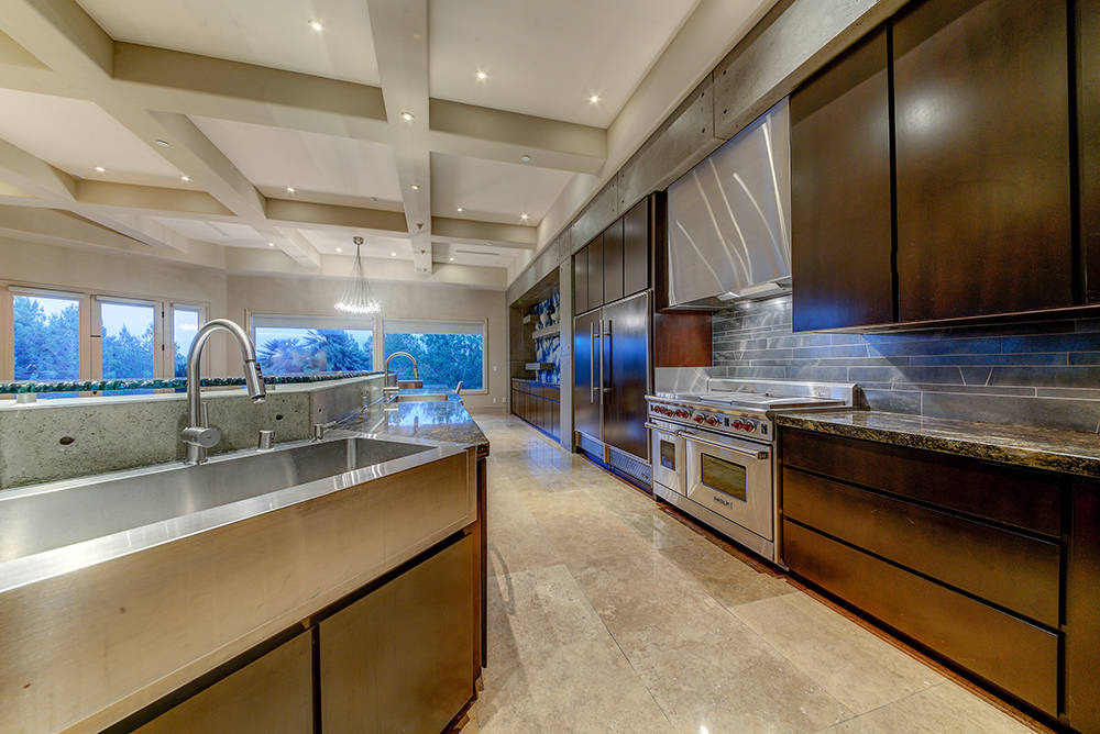 The large kitchen has dark wood cabinets.  (The Napoli Group)