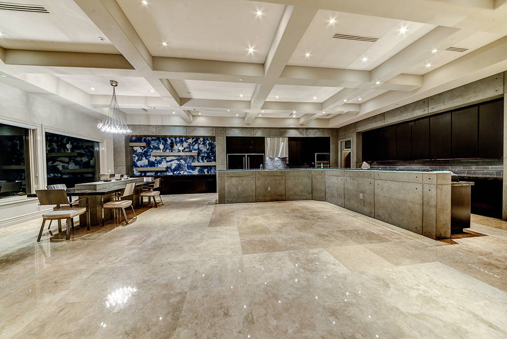 The large kitchen and dining area has a modern design.  (The Napoli Group)