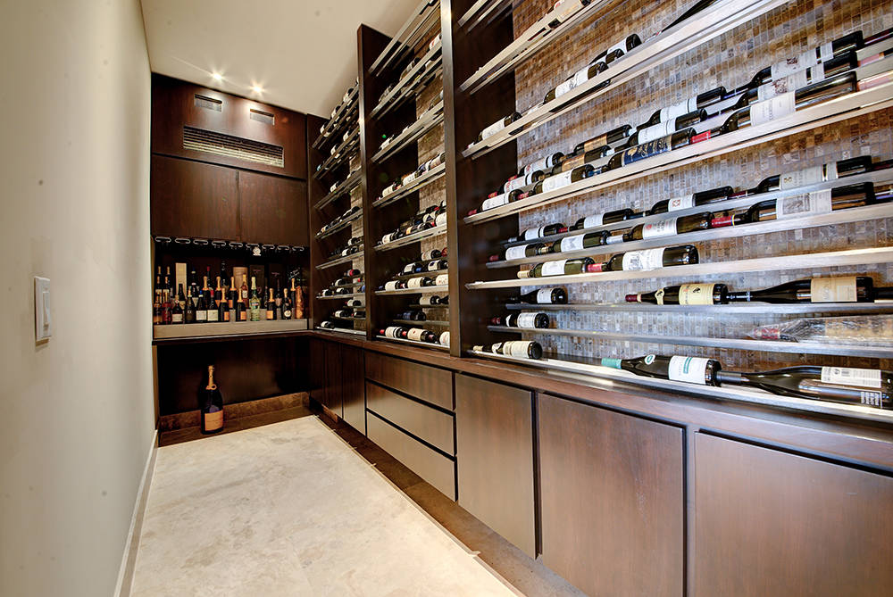 The wine room is off the kitchen area.  (The Napoli Group)