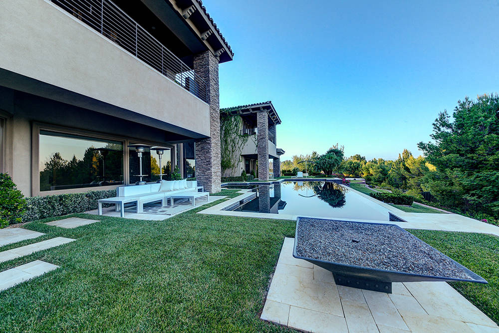 Outside, the home has  an infinity-edge pool and fire features.  (The Napoli Group)