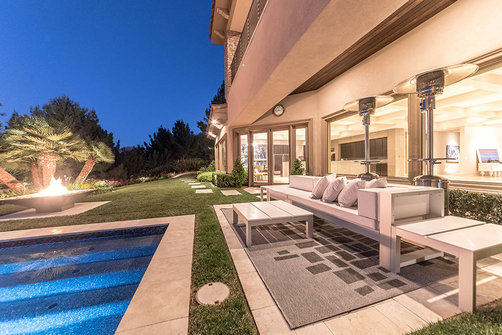 There are several sitting areas around the pool. (The Napoli Group)