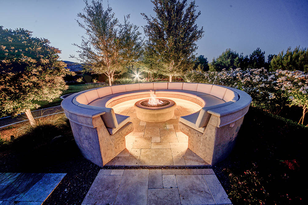 This large seating area around a fire pit is in the private park. (The Napoli Group)