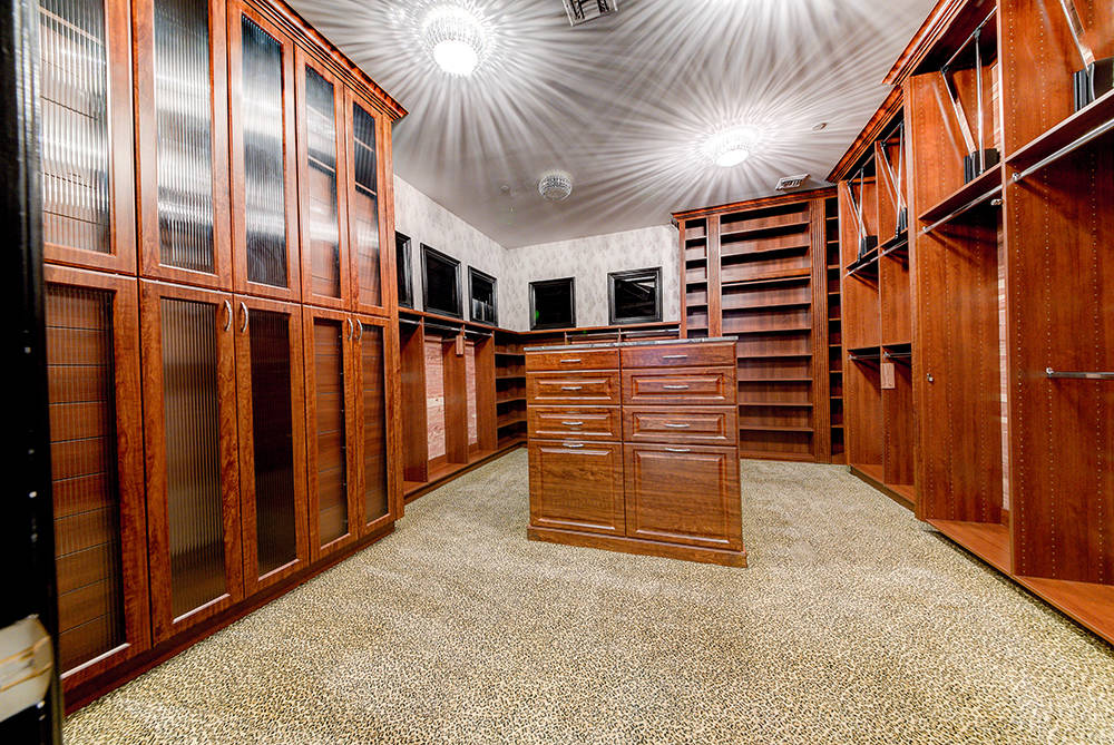 One of two closets adjacent to the master suite. (The Napoli Group)