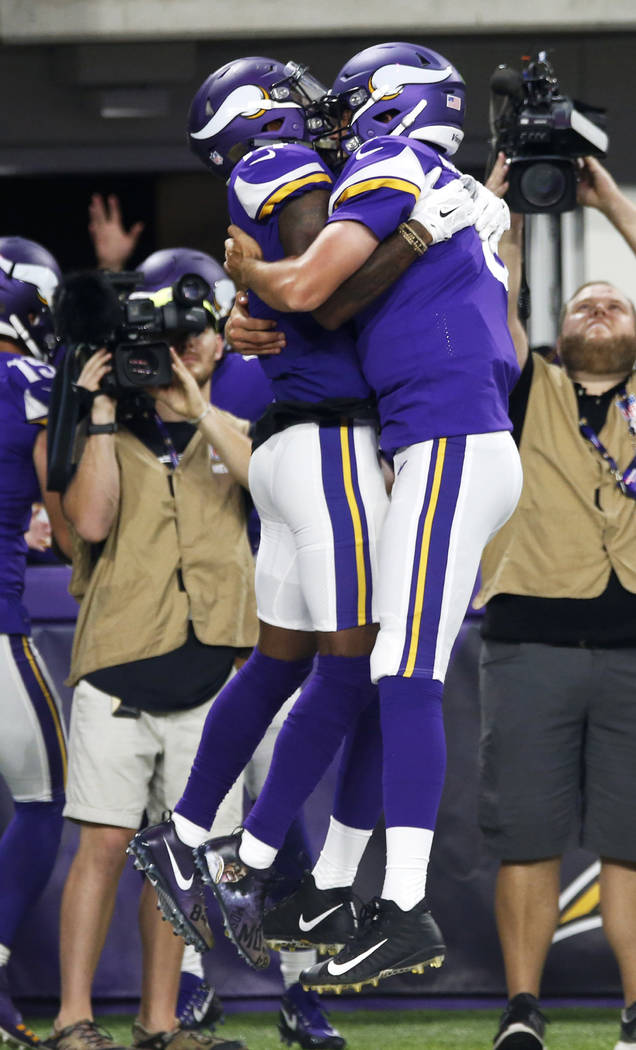 Minnesota Vikings wide receiver Stefon Diggs, left, celebrates with teammate Sam Bradford after catching an 18-yard touchdown pass during the first half of an NFL football game against the New Orl ...