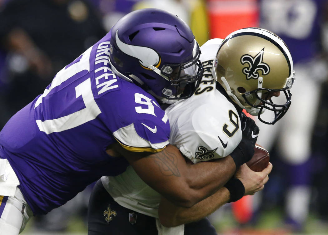New Orleans Saints quarterback Drew Brees (9) is sacked by Minnesota Vikings defensive end Everson Griffen (97) during the first half of an NFL football game, Monday, Sept. 11, 2017, in Minneapoli ...