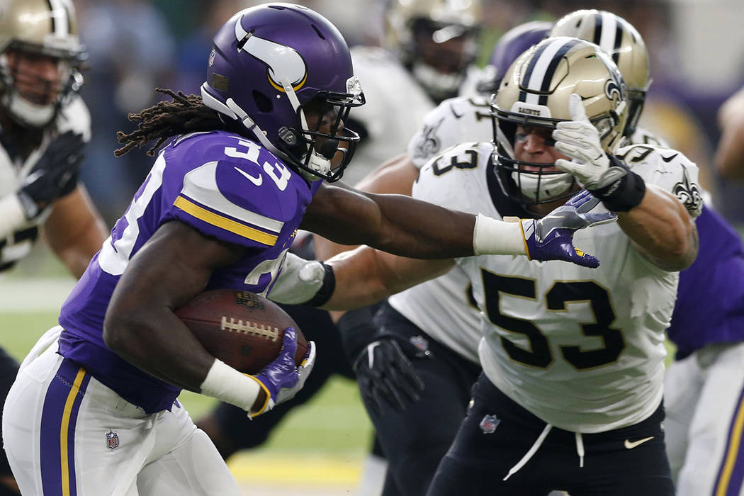Minnesota Vikings running back Dalvin Cook, left, runs from New Orleans Saints linebacker A.J. Klein (53) during the first half of an NFL football game, Monday, Sept. 11, 2017, in Minneapolis. (AP ...