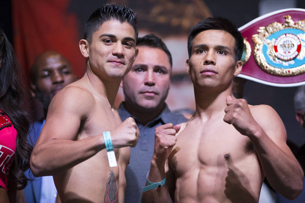Joseph Diaz Jr., left, and Rafael Rivera during a weigh-in event at MGM Grand Garden Arena in Las Vegas, Friday, Sept. 15, 2017. Diaz and Rivera are scheduled to fight on September 16 at T-Mobile  ...