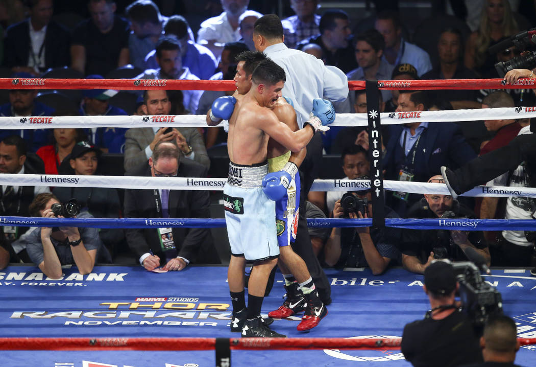 Joseph Diaz Jr., left, embraces Rafael Rivera at the conclusion of their WBC featherweight title eliminator boxing match at T-Mobile Arena in Las Vegas on Saturday, Sept. 16, 2017. Chase Stevens L ...