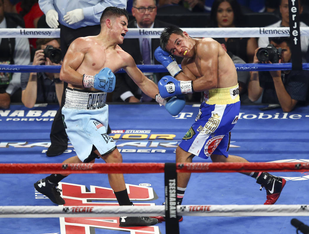 Joseph Diaz Jr., left, hits Rafael Rivera during their WBC featherweight title eliminator boxing match at T-Mobile Arena in Las Vegas on Saturday, Sept. 16, 2017. Chase Stevens Las Vegas Review-Jo ...