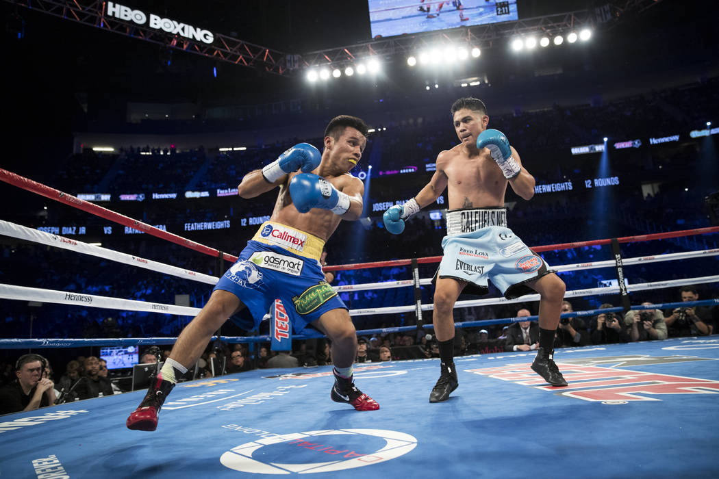 Rafael Rivera, left, battles Joseph Diaz Jr. in the featherweight bout at T-Mobile Arena in Las Vegas, Saturday, Sept. 16, 2017. Diaz won by unanimous decision. Erik Verduzco Las Vegas Review-Jour ...