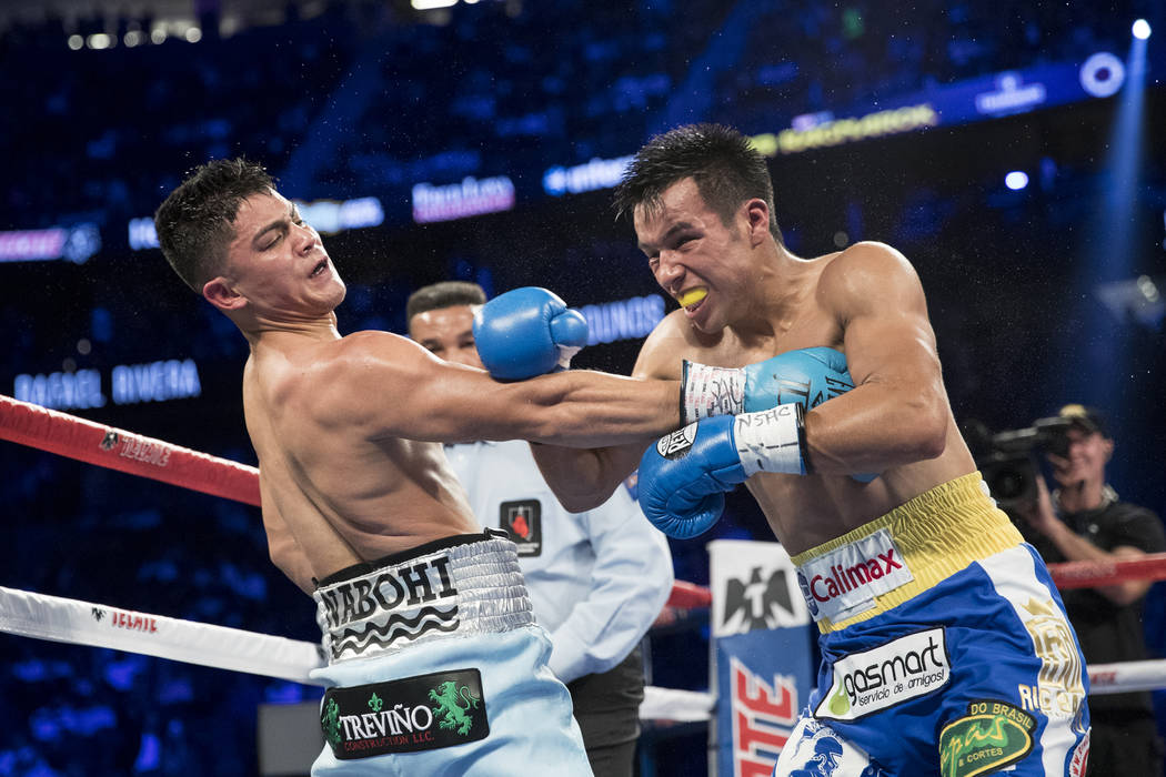 Joseph Diaz Jr., left, battles Rafael Rivera in the featherweight bout at T-Mobile Arena in Las Vegas, Saturday, Sept. 16, 2017. Diaz won by unanimous decision. Erik Verduzco Las Vegas Review-Jour ...