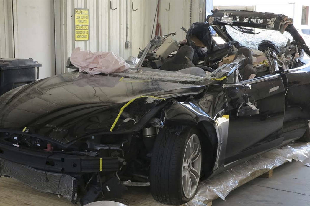 This image provided by the National Transportation Safety Board shows the damage to the left front of the Tesla involved in a May 7, 2016, crash in Williston, Fla. Investigators are meeting Sept.  ...