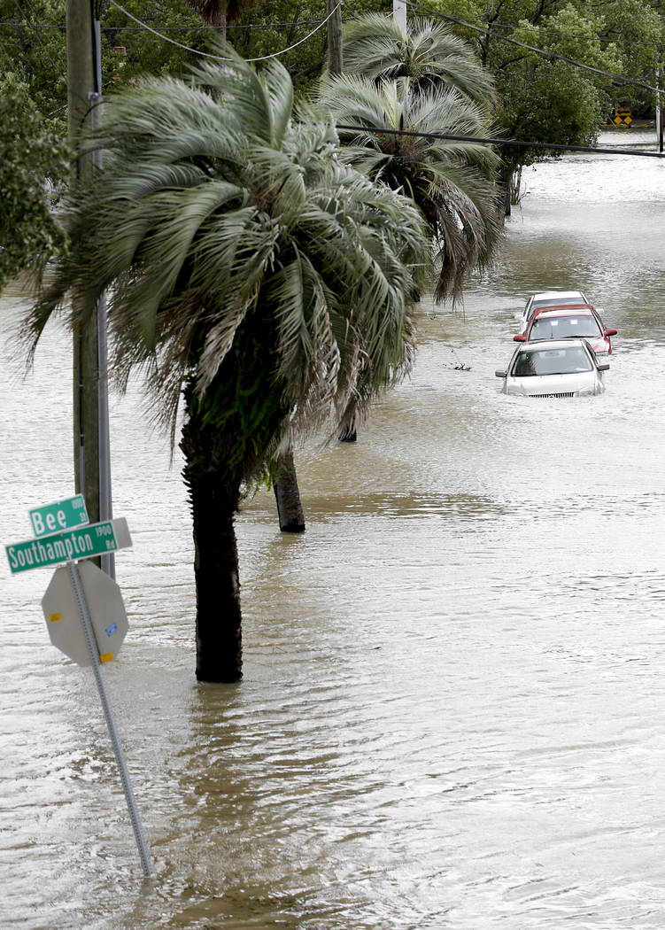 Cars with water up over the doors are parked in a downtown neighborhood after Hurricane Irma brought floodwaters to in Jacksonville, Fla. Monday, Sept. 11, 2017, (AP Photo/John Raoux)