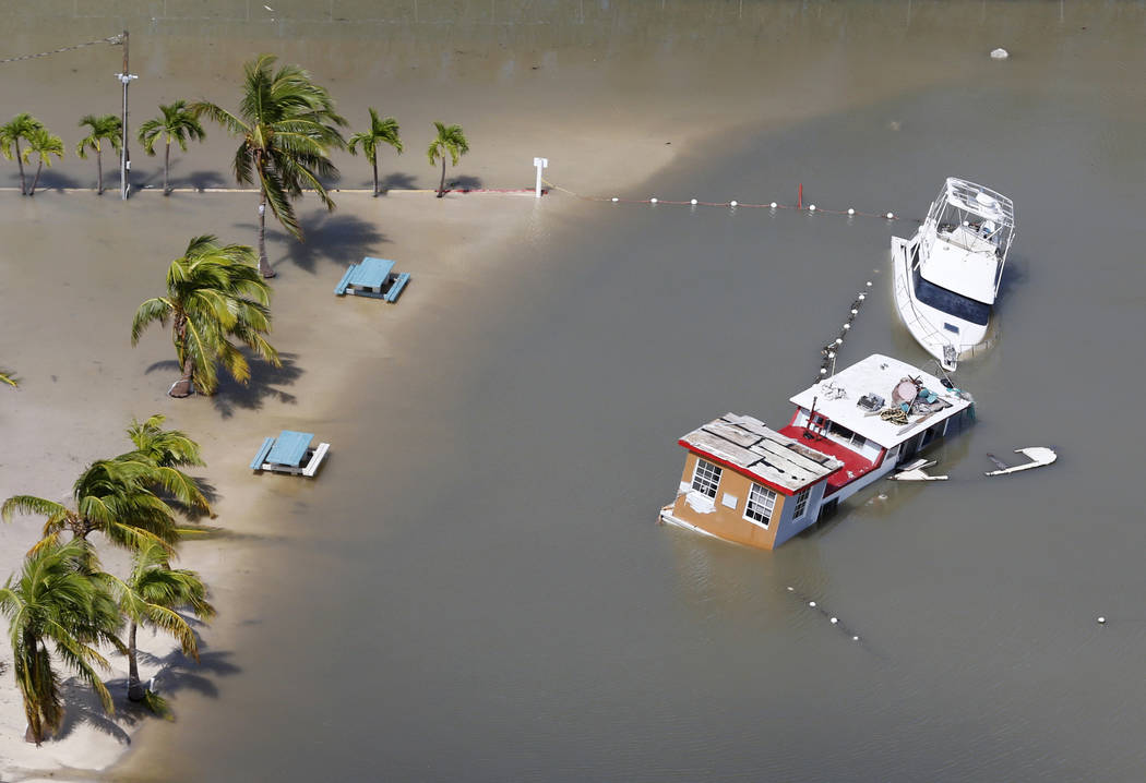 Boats are partially submerged in the wake of Hurricane Irma, Monday, Sept. 11, 2017, in Key Largo, Fla. (AP Photo/Wilfredo Lee)