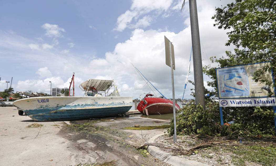 A view of a boats washed ashore at Watson Island in the Hurricane Irma aftermath on Monday, Sept. 11, 2017 in Miami. (David Santiago/Miami Herald via AP)
