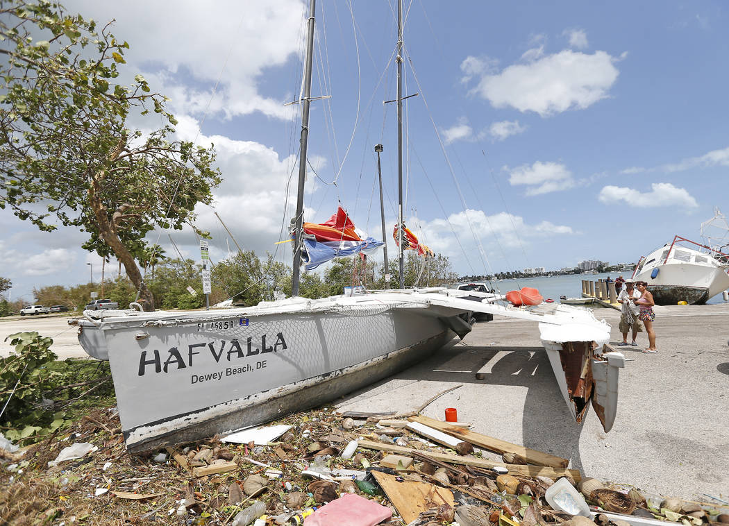 A sailboat washed ashore at Watson Island in the Hurricane Irma aftermath Monday, Sept. 11, 2017 in Miami. (David Santiago/Miami Herald via AP)