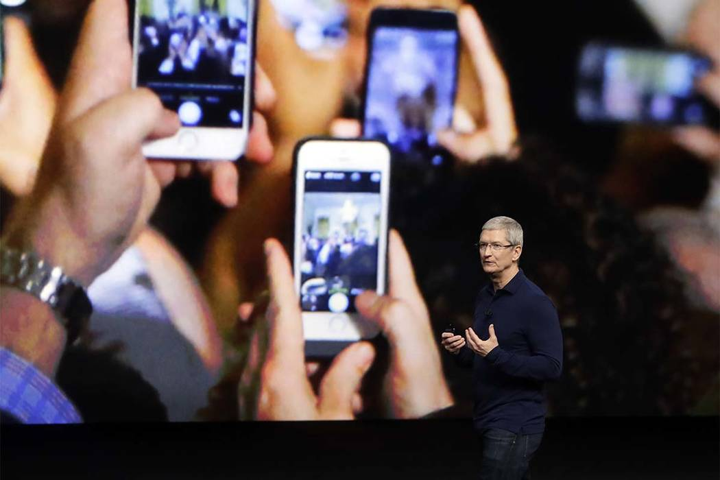 In this Wednesday, Sept. 7, 2016, file photo, Apple CEO Tim Cook announces the new iPhone 7 during an event to announce new products, in San Francisco. Apple is expected to charge $1,000 for the f ...