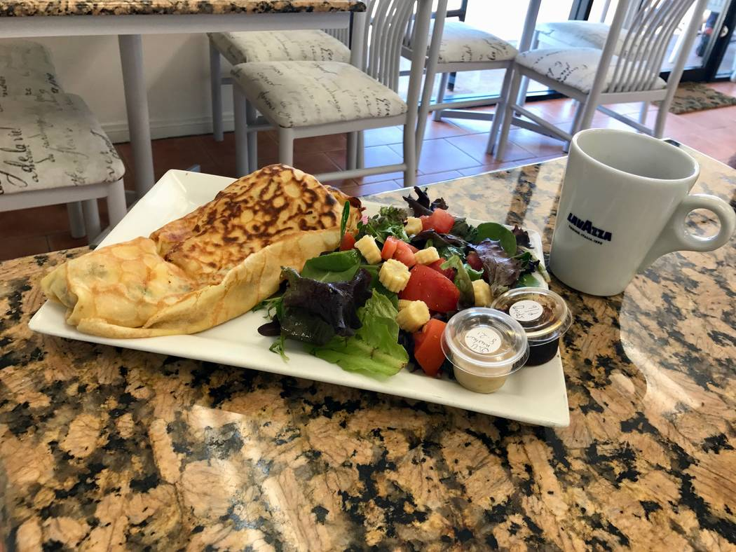 Ham and cheese crepe with a side salad ($8.95) and Americano ($3.10)  (Madelyn Reese/View) @MadelynGReese