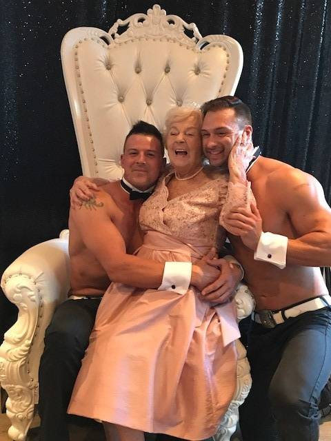 Chippendales James and Nathan surprise Betty Fitzgerald during her 90th birthday bash. (Courtesy)