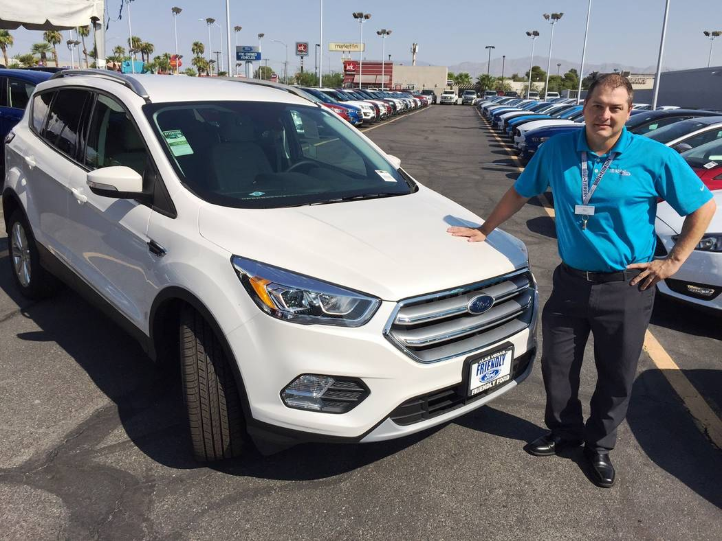 Friendly Ford Friendly Ford sales consultant Joseph Christensen is seen with a 2017 Ford Escape SUV at the dealership located at 660 N. Decatur Blvd.