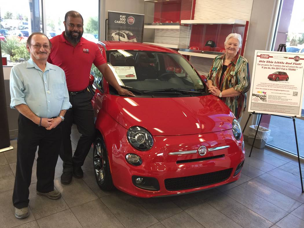 Findlay The Little Red Fiat promotion to benefit Henderson's City Lights Art Gallery will run through Oct. 6. Shown with the vehicle are, from left, Tommy Tucker of City Lights Art Gallery; Find ...