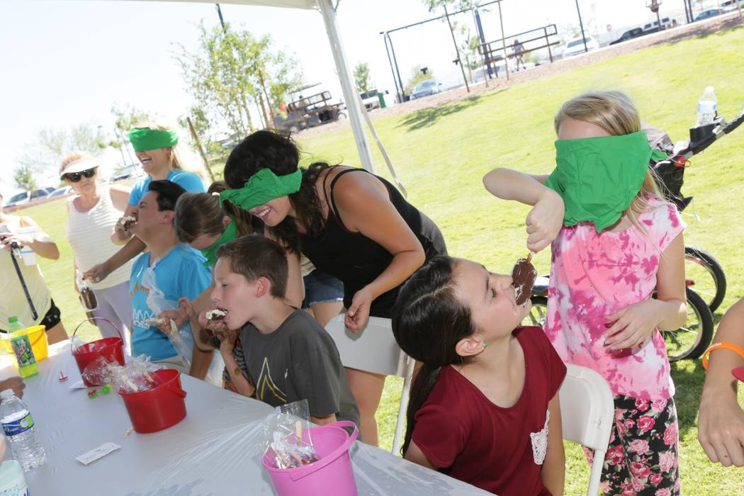 People participate in an ice cream-eating contest at a previous Sunny 106.5 Ice Cream Sunday. This year's event will be held Sunday at Providence. (Providence)