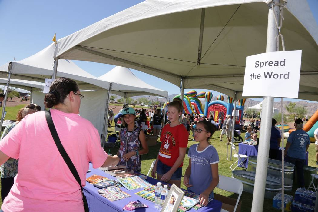 Donating gently used books for Spread the Word Nevada has become a tradition at the annual  Sunny 106.5 Ice Cream Sunday event. (Providence)