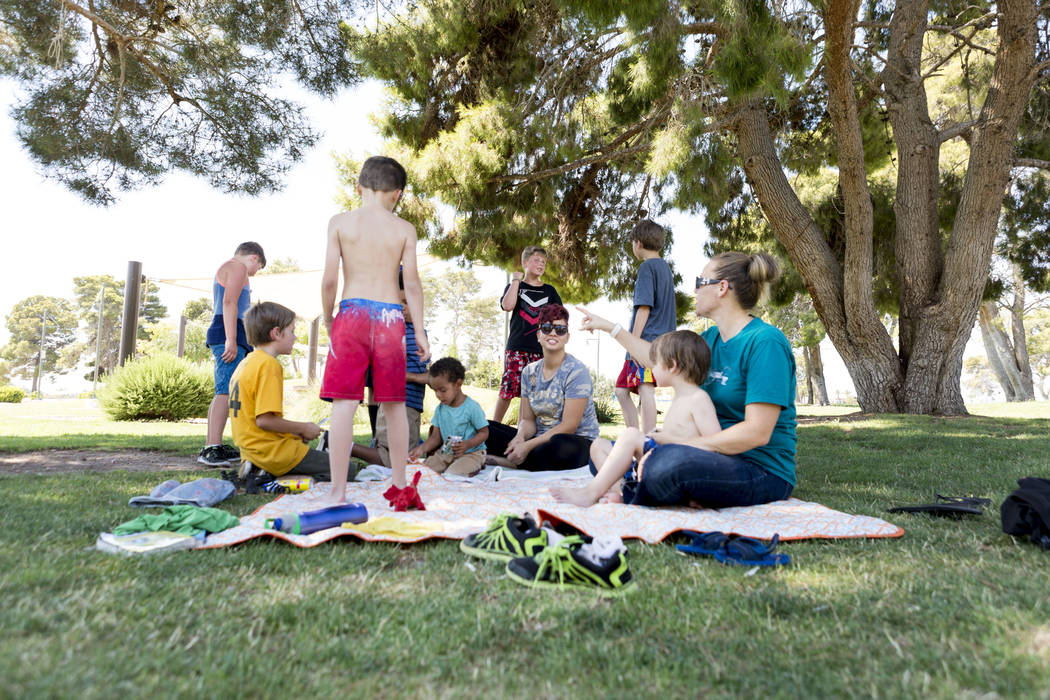 People stay in the shade at Craig Ranch Regional Park in North Las Vegas, Thursday, July 6, 2017. Elizabeth Brumley Las Vegas Review-Journal