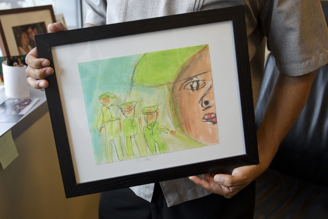 North Las Vegas Councilman Isaac Barron holds up an art piece from the Stone Soup Gallery in the North Las Vegas City Hall on Thursday, June 9, 2016. Loren Townsley/Las Vegas Review-Journal Follow ...