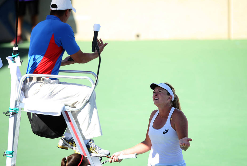 CoCo Vandeweghe, right, argues with chair umpire Alex Nieto in the finals of the Party Rock Open tennis tournament at Darling Tennis Center in Las Vegas Sunday, Sep. 29, 2013. Vandeweghe was defea ...