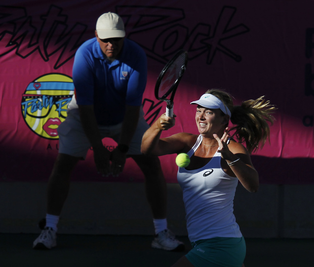 CoCo Vandeweghe returns a shot against Anna Tatishvili  during their semi-final match of the Party Rock Open at the Darling Tennis Center in Las Vegas on Sept. 28, 2013. (Jason Bean/Las Vegas Revi ...