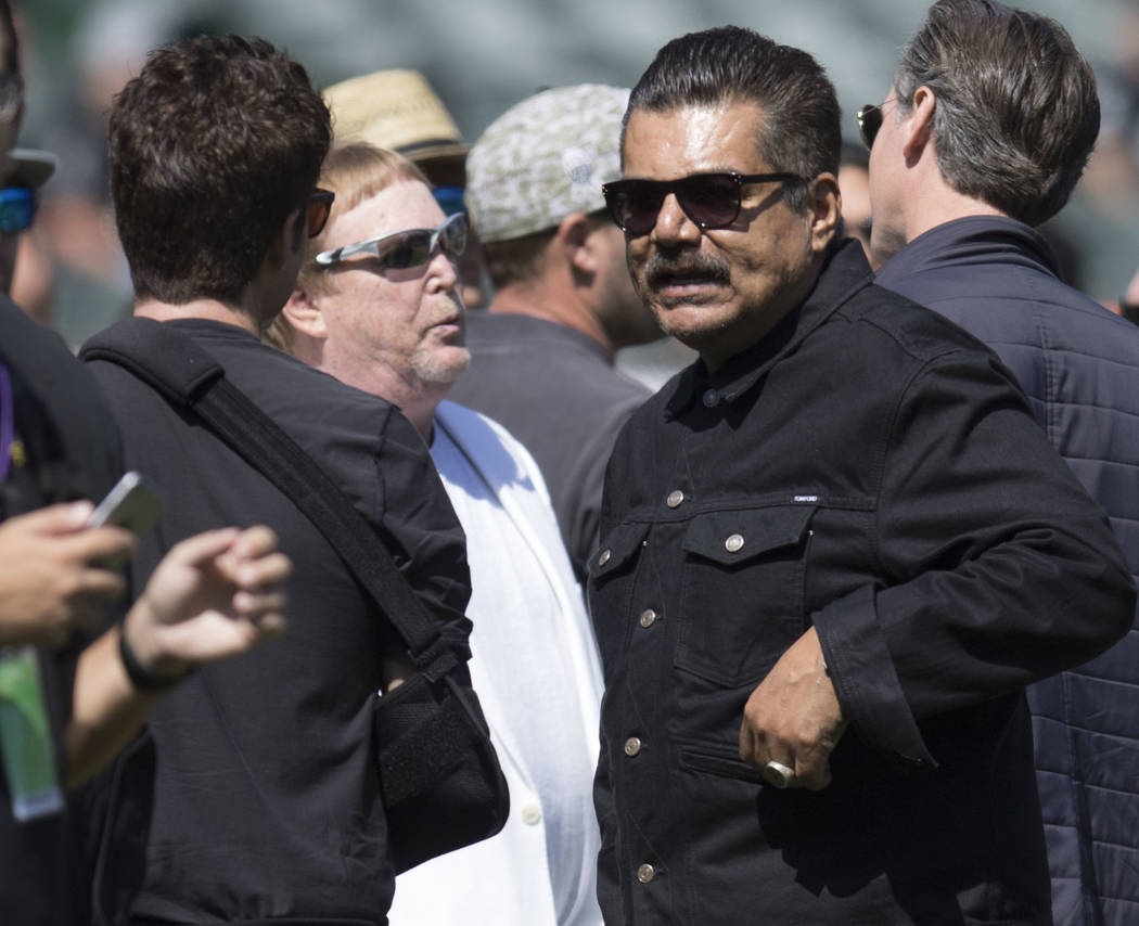 Oakland Raiders owner Mark Davis, left, with comedian George Lopez on the field prior to the start of the team's game against the New York Jets in Oakland, Calif., Sunday, Sept. 17, 2017. Heidi Fa ...