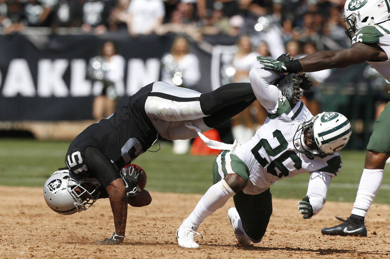 Sep 17, 2017; Oakland, CA, USA; Oakland Raiders wide receiver Michael Crabtree (15) is upended by New York Jets free safety Marcus Maye (26) after making a catch in the second quarter at Oakland C ...