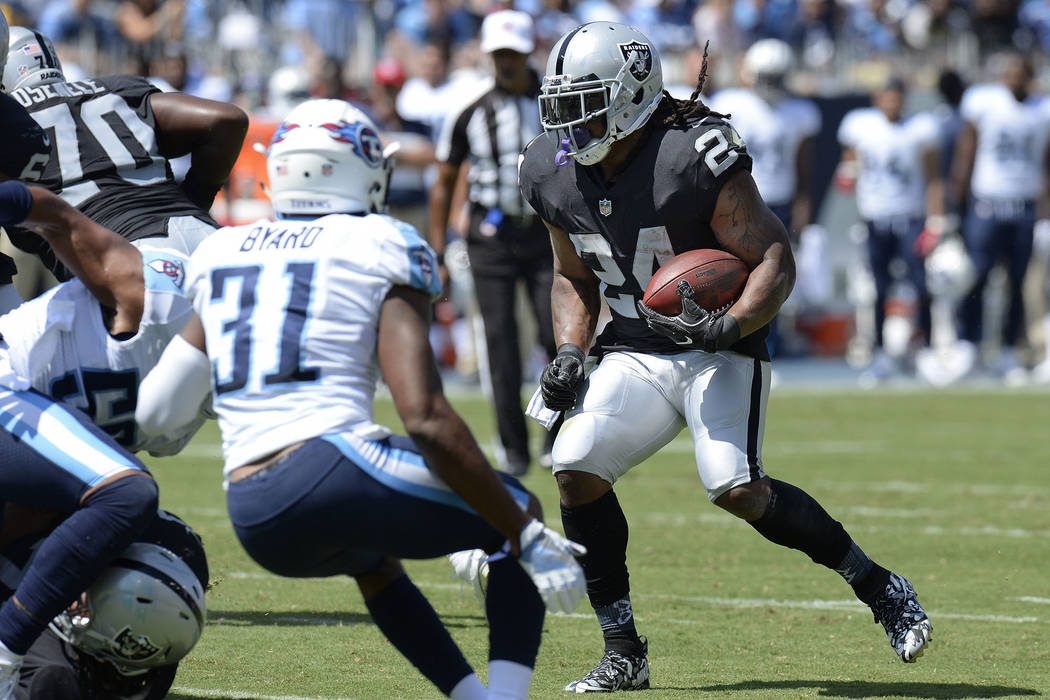 Oakland Raiders running back Marshawn Lynch (24) runs the ball against Tennessee Titans free safety Kevin Byard (31) in the first half of an NFL football game Sunday, Sept. 10, 2017, in Nashville, ...